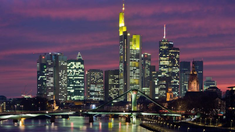 Frankfurt on the Main: View of the city as seen from the Deutschherrnbruecke (Teutonic Knights Bridge) at dusk