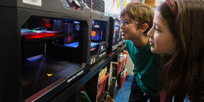 Kids in front of makerbot